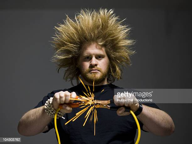 man holding jumper cables