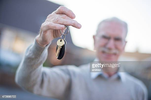 Man holding keys to a house