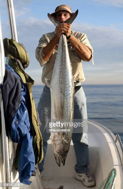 Man Holding Large King Mackerel Fish