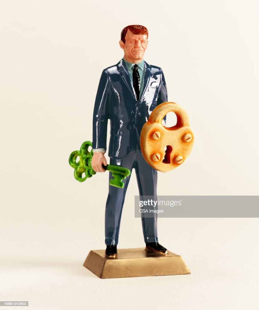 Man Holding Lock and Key : Stock Photo