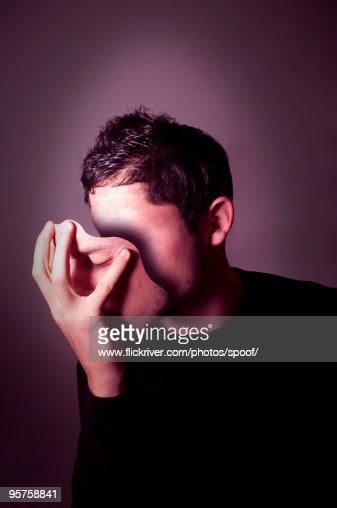 Man holding mask