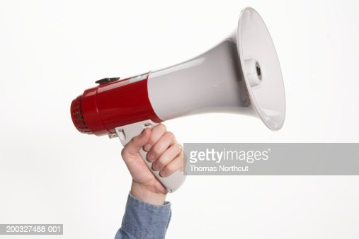 Man holding megaphone, close-up of hand