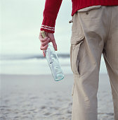 Man holding message in a bottle