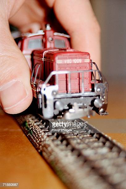 Man holding model train