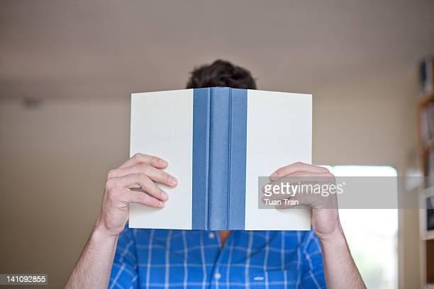 Man holding open book