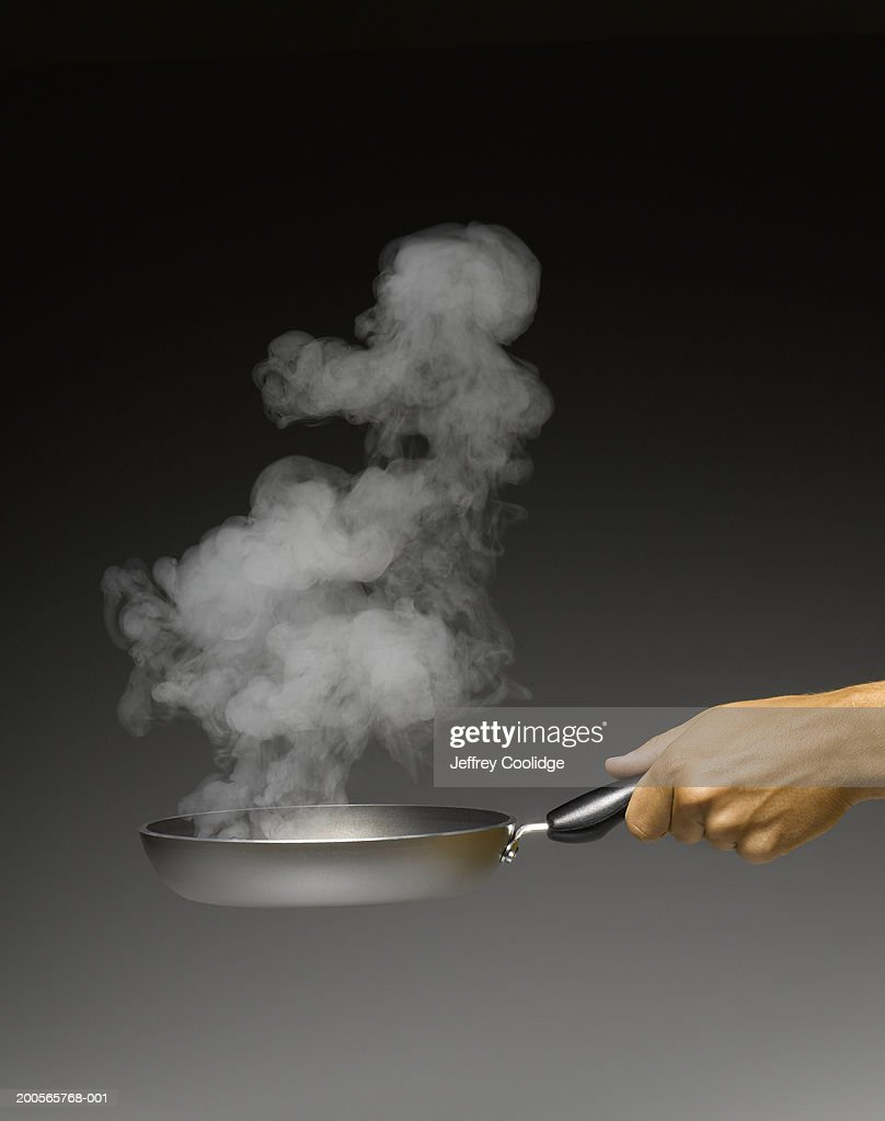 Man holding pan in hand, close-up : Stock Photo