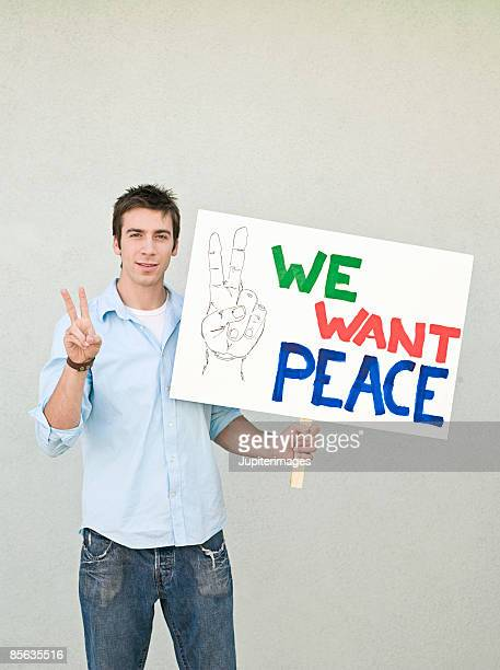 Man holding peace sign