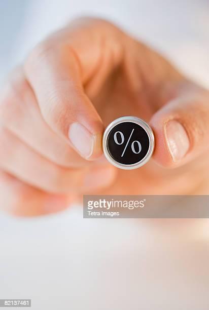 Man holding percent symbol