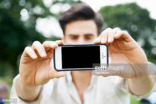 man holding phone up to camera