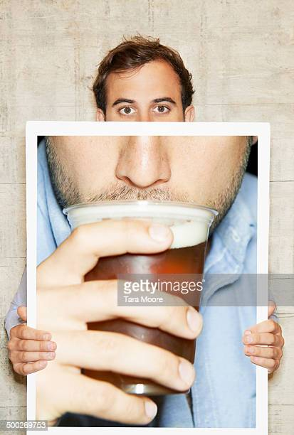 man holding picture of beer