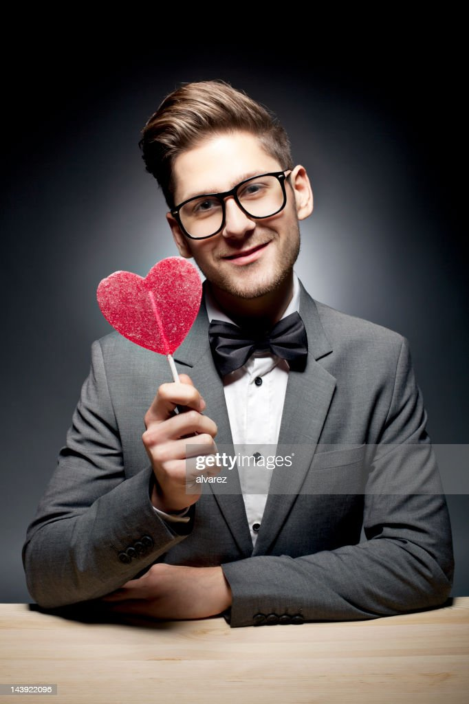 Man holding pink heart candy : Stock Photo
