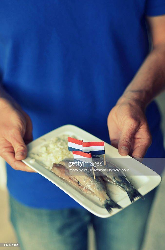 Man holding plate : Stock Photo