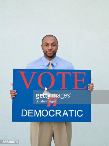 Man holding political sign : Stock Photo
