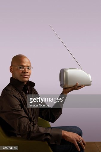 Man holding portable television