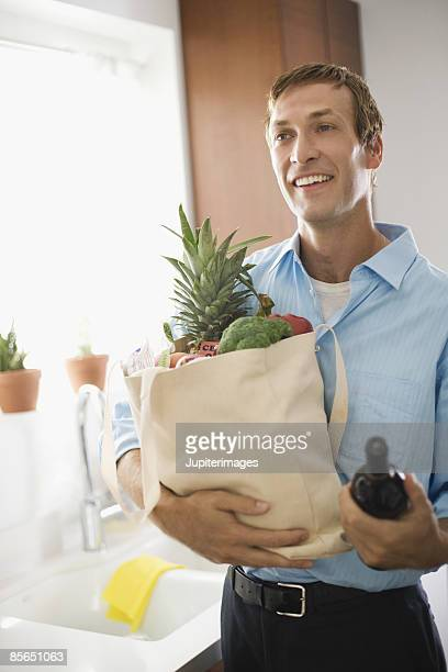 Man holding produce in eco-friendly canvas bag