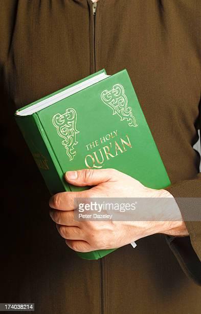 Man holding Qur'an