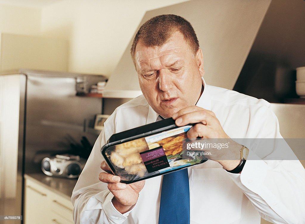 Man Holding Reading Label on Food : Stock Photo