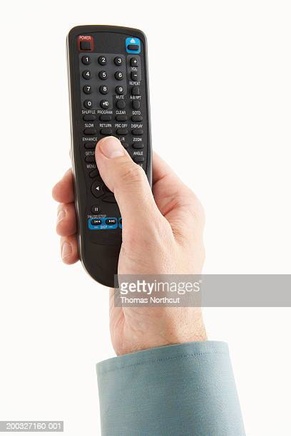 Man holding remote control, close-up of hand, overhead view