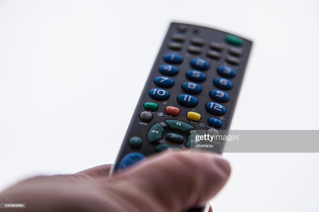 man holding remote control : Stock Photo