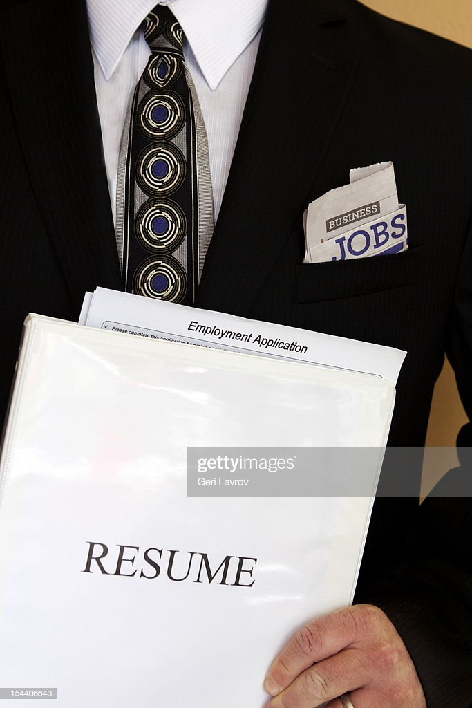 Man Holding Resume Binder And Job Application Stock Photo  Resume Binder
