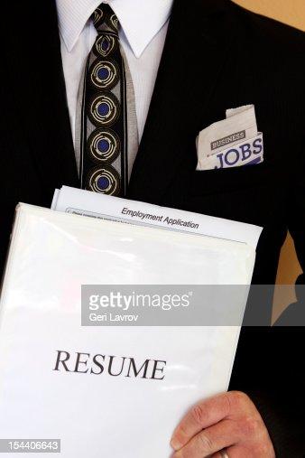 man holding resume binder and job application stock photo