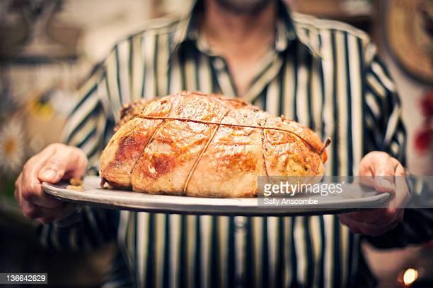 Man holding roast turkey