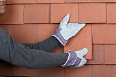 Man holding roof tiles