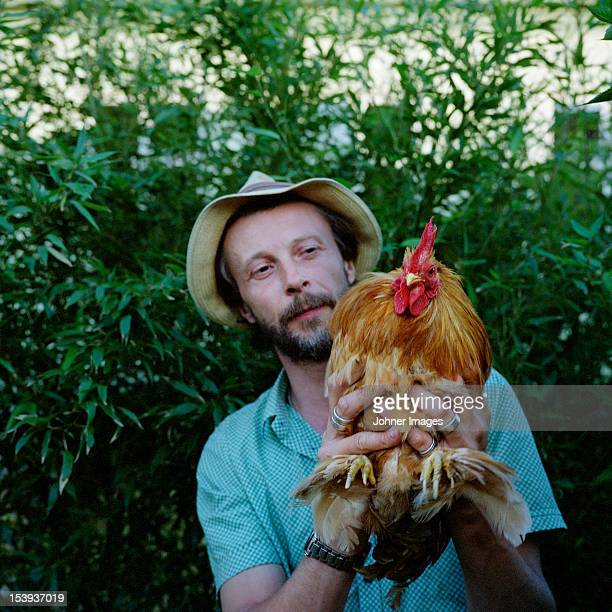 Man holding rooster