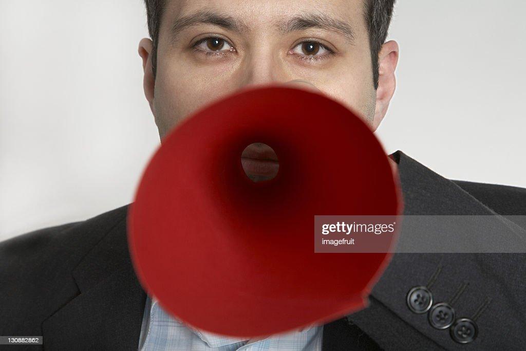 Man holding self-made megaphone : Stock Photo