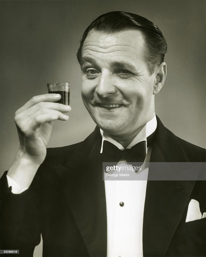 Man holding shot of alcohol : Stock Photo