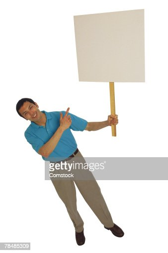 Man holding sign and pointing