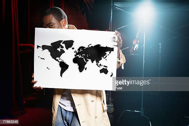 Man Holding Sign of World Map