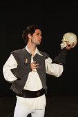 Man holding skull