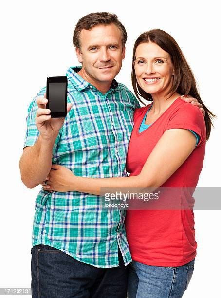 Man Holding Smart Phone While Wife Embracing Him - Isolated