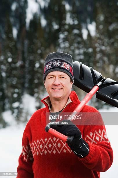 Man holding snow shovel