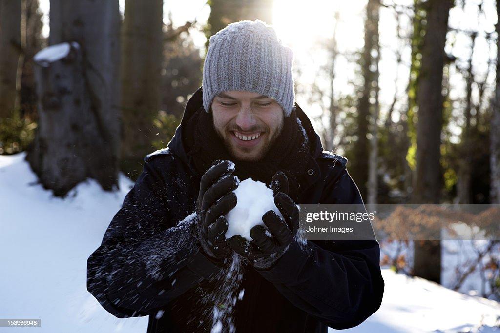 Man holding snowball : Stock Photo