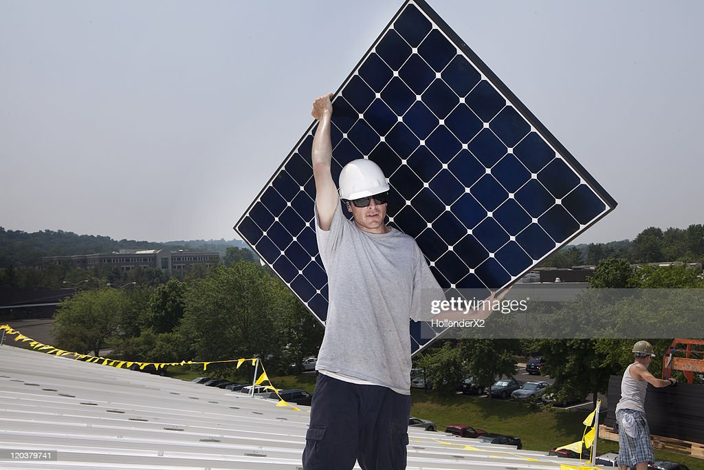 Man holding solar panel : Stock Photo
