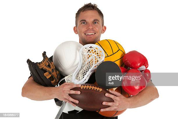 Man holding sports equiments