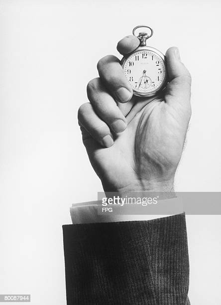 Man holding stopwatch, close up of hand