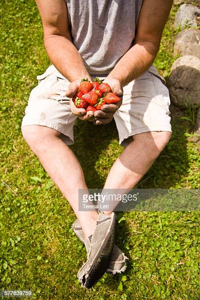 Man holding strawberries