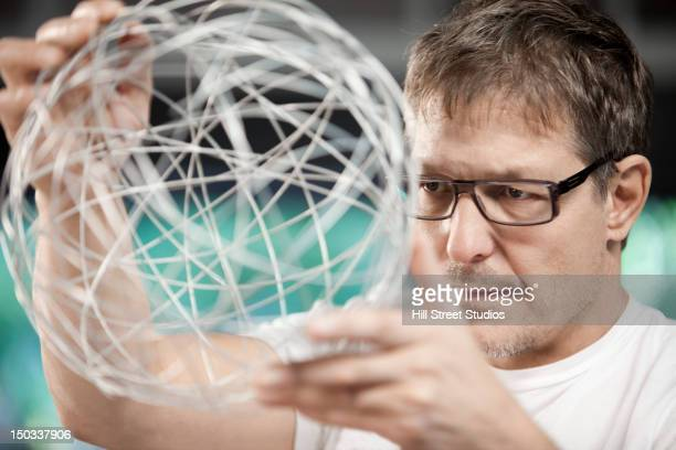 Man holding string globe