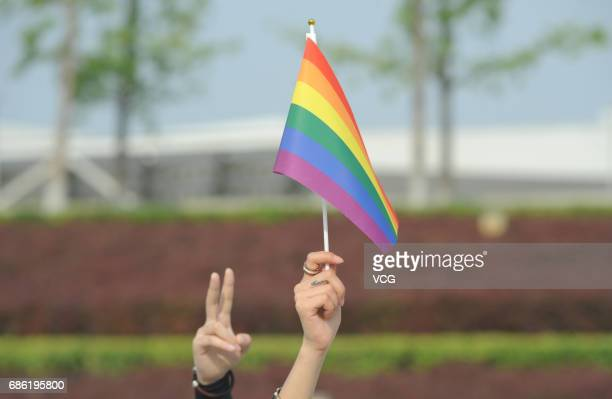 A man holding the rainbow flag participates in the color run on May 21 2017 in Taiyuan Shanxi Province of China Around 300 people including about 20...