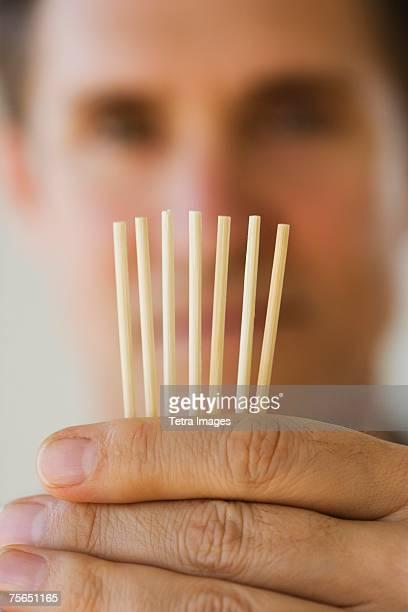 Man holding toothpicks