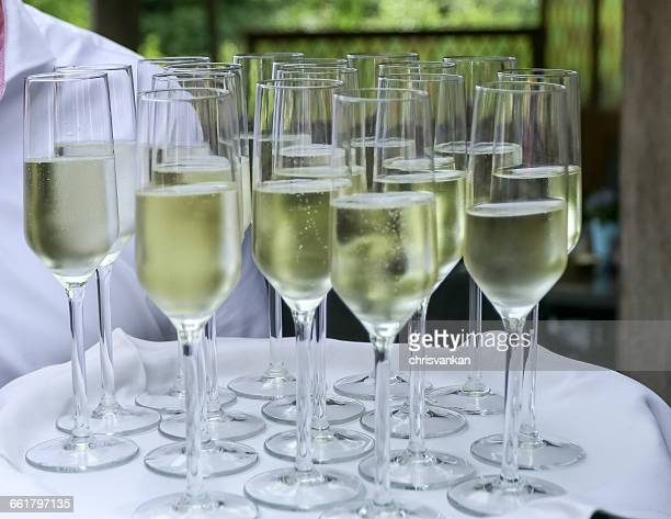 Man holding tray with glasses of champagne