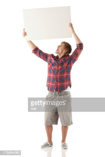 Man holding up a placard
