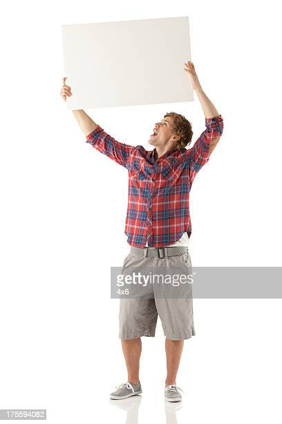 Man holding up a placard