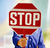 Man holding up stop sign