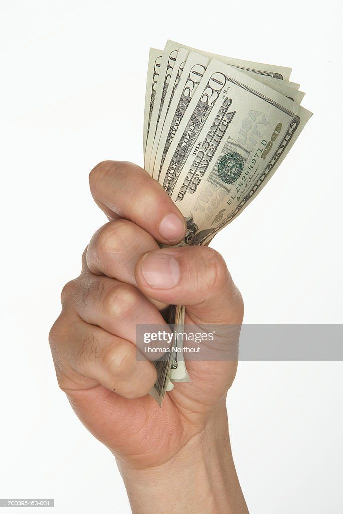 Man holding US currency (focus on bills) : Stock Photo