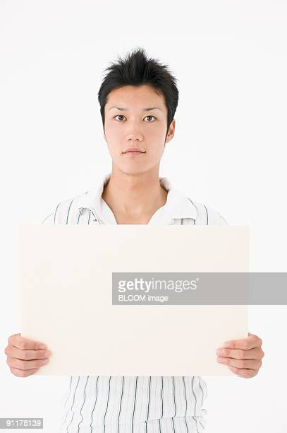 Man holding whiteboard