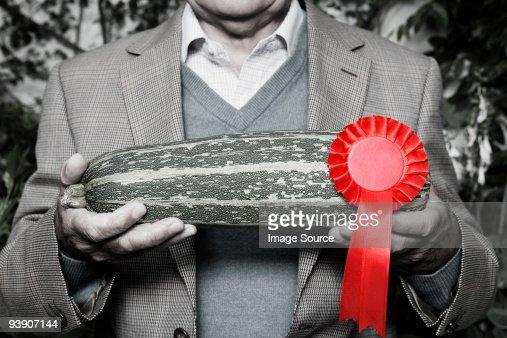 Man holding winning marrow : Stock Photo